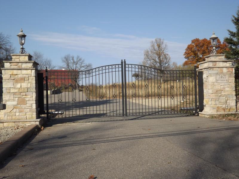 Unique fence designs fence installation in st paul for Ready made driveway gates