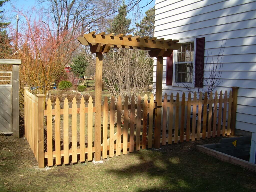 Wood fence in st paul lakeville twin cities woodbury for Fence with arbor