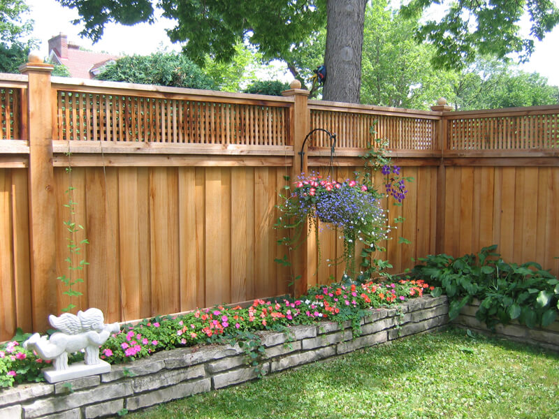 Wood privacy fence in st paul lakeville twin cities for Lattice garden fence designs